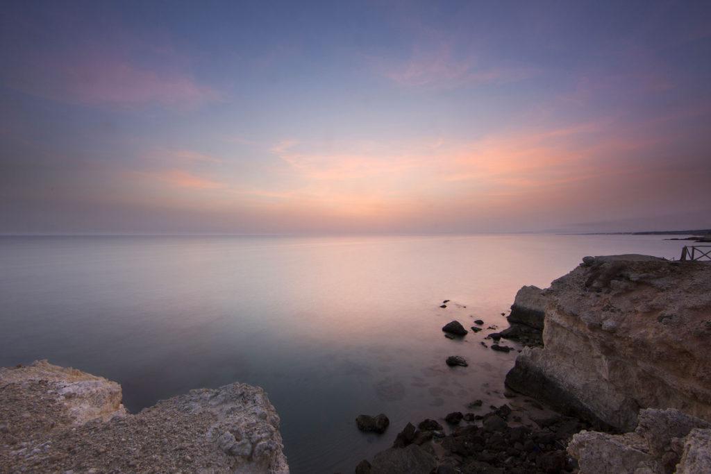 fotografia di paesaggio, mare, terra, e tramonto